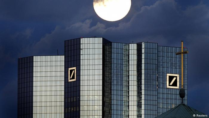 Archive photo: A rising full moon is seen over the twin towers of Germany's Deutsche Bank headquarters in Frankfurt January 28, 2002. (Photo via REUTERS/Kai Pfaffenbach)
