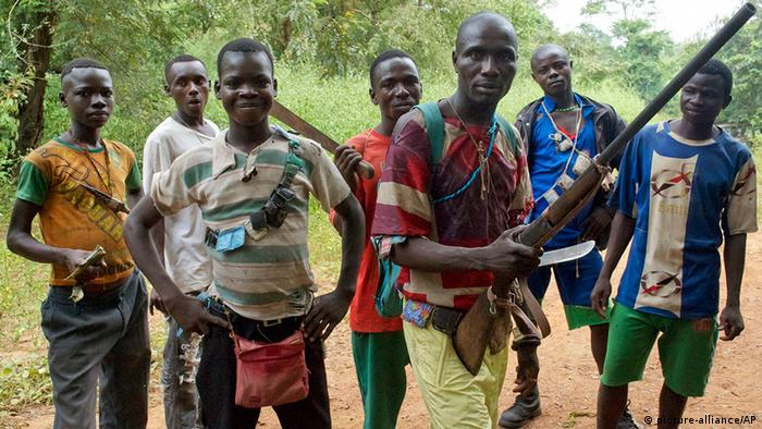 Fighters from a Christian militia movement known as the anti-balaka display their makeshift weaponry in the village of Boubou (photo: AP Photo/Florence Richard)