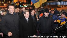 German Foreign Minister Guido Westerwelle (C) and Ukrainian boxing champion Wladimir Klitschko (L) visit protesters during an opposition rally at Maidan Nezalezhnosti in Kiev on December 4, 2013. Westerwelle said the gates of Europe were still open for Ukraine, after mass protests against the government's decision to walk away from a deal with the European Union. AFP PHOTO/GENYA SAVILOV (Photo credit should read GENYA SAVILOV/AFP/Getty Images)