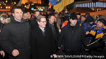 Guido Westerwelle and one of the Klitschko brothers in Kyiv