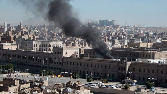 A ministerial building in Yemen emits a black plume of smoke after a terror attack.