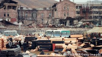 Scores of coffins are stored in an open space after the Spitak earthquake