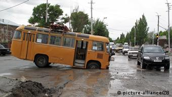 A bus in Gyumri drives into deep water on a suburban road