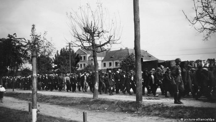 Nazi soldiers march a line of Yugoslavian prisoners of war through Belgrade in 1941