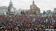 Supporters of EU integration hold a rally at Maidan Nezalezhnosti or Independence Square in central Kiev, December 8, 2013. Pro-Europe protesters flocked to Kiev's Independence Square on Sunday for a rally that organisers were hoping would swell to 1 million people, piling pressure on Ukrainian President Viktor Yanukovich to turn back from seeking closer ties to Russia. REUTERS/Gleb Garanich (UKRAINE - Tags: POLITICS CIVIL UNREST)