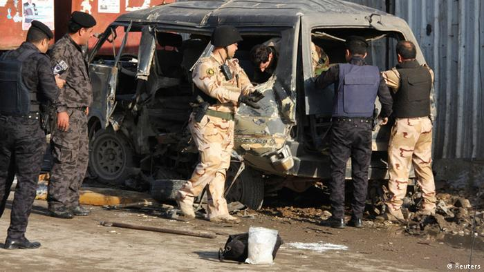 A bombed out mini-bus in Baghdad. Photo: Reuters