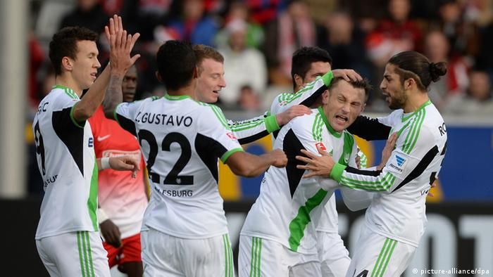 Wolfsburg celebrate Ivica Olic's goal during their 3-0 defeat of Freiburg on Sunday in the Bundesliga. Photo: dpa
