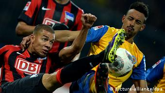 Braunschweig and Hertha players battle for the ball