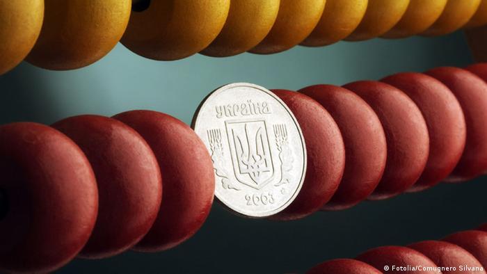 Рахівниця з українською монетою