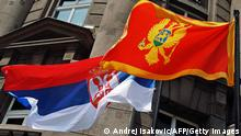 The flags of Serbia and Montenegro fly in front of the Foreign Ministry building in the Serbian capital of Belgrade