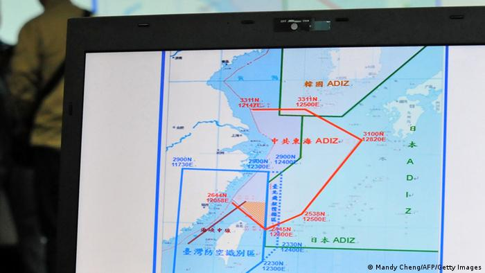 A map of Air Defence Identification Zone (ADIZ) in the East China Sea is displayed during a press conference in Taipei on December 2, 2013. Taiwan said its military planes have made about 30 flights into a part of China's newly declared air defence zone which overlaps a similar Taiwanese zone. Photo: Mandy Cheng/AFP/Getty Images)