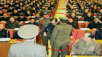 Jong-un's uncle Jang Song-thaek (C) being arrested during an enlarged meeting of the Political Bureau of the Central Committee of the Workers' Party in Pyongyang, North Korea, 08 December 2013. Jang has been removed from power, North Korea's state news agency confirmed 09 December. The husband of Kim's aunt Kim Kyong Hui, was vice chairman of the powerful National Defence Commission and widely seen as the second most-influential figure in the nation. EPA/YONHAP SOUTH KOREA OUT.