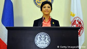 Yingluck Shinawatra - Thai Prime Minister Yingluck Shinawatra speaks at the police headquarter in Bangkok on December 9, 2013. (Photo: AFP)