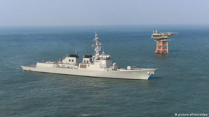 A picture made available by the South Korean Navy on 03 December 2013 shows South Korean 7,600-ton Aegis destroyer Yulgok YiYi patroling in waters around Ieodo, South Korea's submerged rock south of Jeju Island, South Korea, 02 December 2013. China recently declared its expanded air defense zone, in which Ieodo falls, raising tension with South Korea, Yonhap News Agency reports. EPA/YONHAP