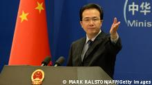 The Chinese Foreign Ministry spokesman Hong Lei gestures during a press briefing in Beijing on April 8, 2013. North Korea appears to be preparing a fourth nuclear test as well as a provocative missile launch, South Korea said, despite an unusually blunt call from China for restraint. AFP PHOTO/Mark RALSTON (Photo credit should read MARK RALSTON/AFP/Getty Images)