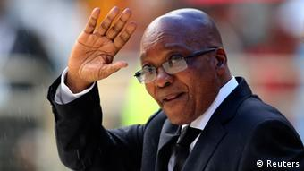 President Zuma waves to the crowd at the memorial ceremony