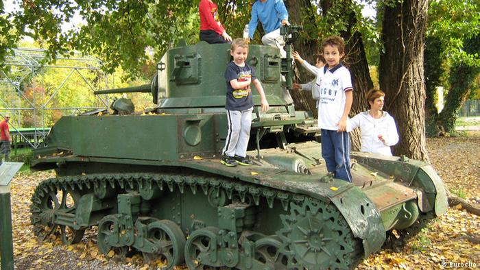 kids playing on an old tank