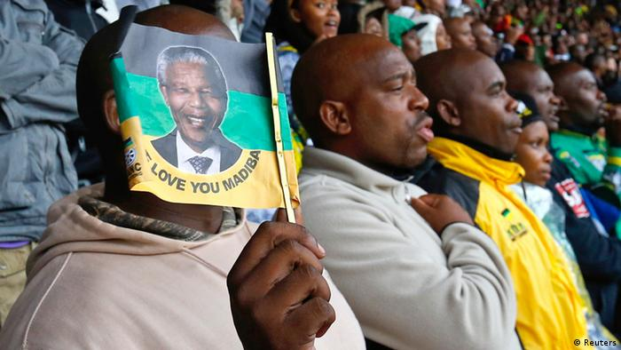mourners in FNB stadium singing