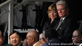 German president Joachim Gauck with his wife at the Mandela memorial ceremonyr