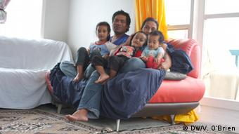 Ioane Teitota and his wife on the sofa with their three children