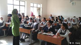 A classroom of pupils and a teacher in Zahawi School