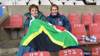 Janet Voekel and a friend wrapped in a blanket, sitting in Ellis Park Stadium