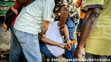 An opposition man is arrested during a demonstration held to commemorate Human Rights Day in downtown Havana, on December 10, 2013. AFP PHOTO/ADALBERTO ROQUE (Photo credit should read ADALBERTO ROQUE/AFP/Getty Images)