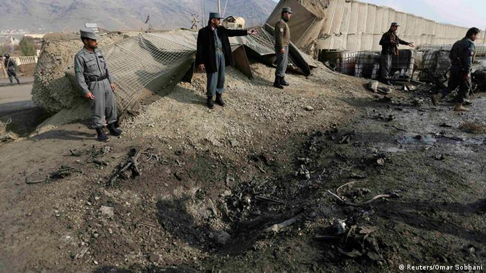 Afghan authorities look over wreckage of an attack in Afghanistan Photo: REUTERS/Omar Sobhani