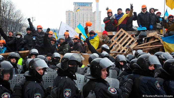 Ukrainian protesters and police forces clash on Maiden square in Kyiv
