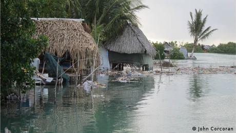 Homes during high tide in Kiribati (photo: John Corcoran)