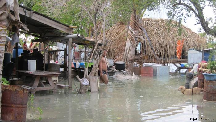 People trying to protect their belongings in Kiribati, May 2011. Copyright: John Corcoran