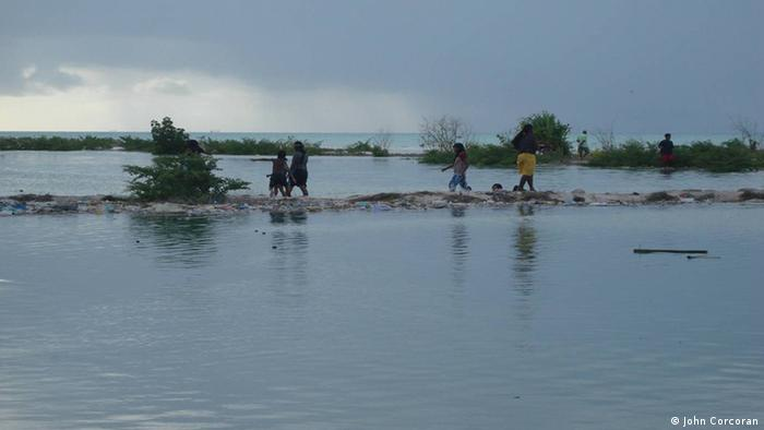 Waiting for the tide to go down in Kiribati (photo: John Corcoran)