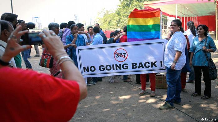 People protest the Supreme Courts decision in New Delhi, 11 Dec 2013