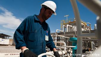 A worker at the Tawke oil field in northern Iraq