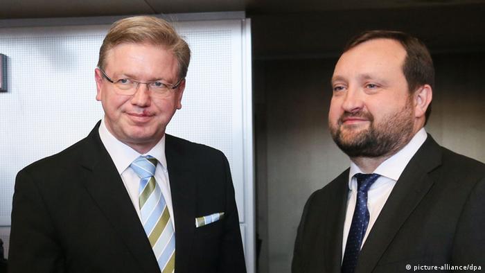 Бывший и.о. премьера Украины Сергей Арбузов (справа) в ходе визита в Брюссель (2013 год)