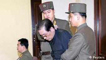 Jang Song Thaek being led away by security forces (Photo: REUTERS/Yonhap - cannot be independently confirmed)