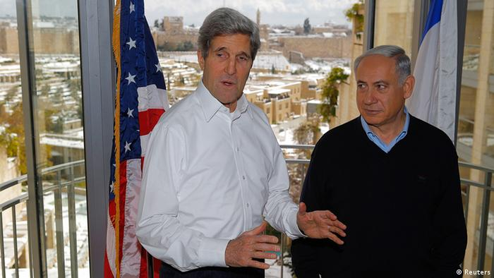 US Secretary of State John Kerry (L) and Israeli Prime Minister Benjamin Netanyahu talk to reporters from a room overlooking the snow covered city of Jerusalem, during a meeting December 13, 2013. REUTERS/Brian Snyder