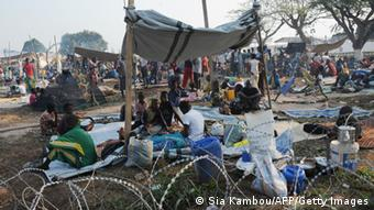 People in a refugee camp (photo: Sia Kambou/AFP/Getty Images)