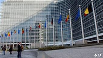 The European Commission building, lined with flags