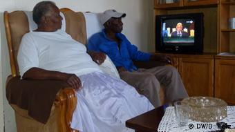 Sam and Rhoda Hlatshwayo in front of their TV