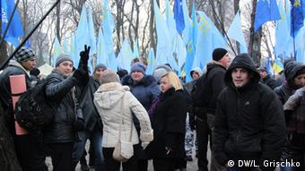 People with blue flags (Photo: Grischko)