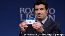 Champions League's final ambassador Portugese Luis Figo holds up the name of Chelsea FC during the draw for the last 16 of the UEFA Champions league tournament at the UEFA headquarters in Nyon on December 16, 2013. AFP PHOTO / FABRICE COFFRINI (Photo credit should read FABRICE COFFRINI/AFP/Getty Images)