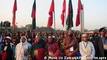 Bangladeshi people sing the national anthem at 4.31pm, the exact moment when the Pakistan army surrendered on this day in 1971, as they gather at a rally to mark the country's Victory Day in Dhaka on December 16, 2013. Bangladesh won independence from Pakistan after a bitter nine-month war in 1971 led by the country's founder Sheikh Mujibur Rahman, and this is celebrated every year on December 16. AFP PHOTO/ Munir uz ZAMAN (Photo credit should read MUNIR UZ ZAMAN/AFP/Getty Images)