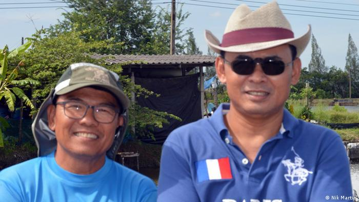 Farmers Banjong Nisapawanich and Udorn Songserm have been hit by EMS among their shrimp stock (Photo: Nik Martin)