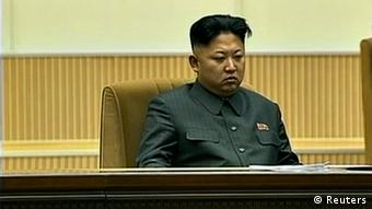 North Korean leader Kim Jong Un (C) attends a mass indoor memorial rally in Pyongyang in this still image taken from video released by KRT, North Korean state TV on December 17, 2013 (Photo: REUTERS/KRT via Reuters TV)