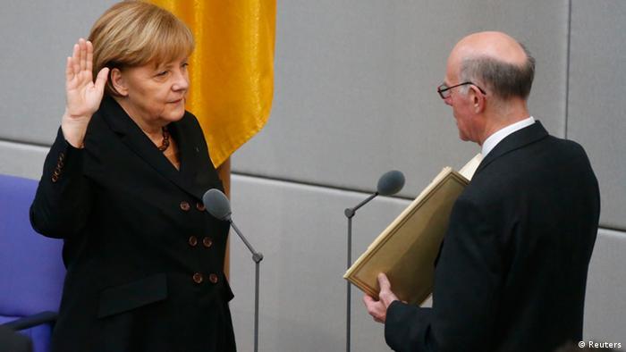Merkel being sworn in