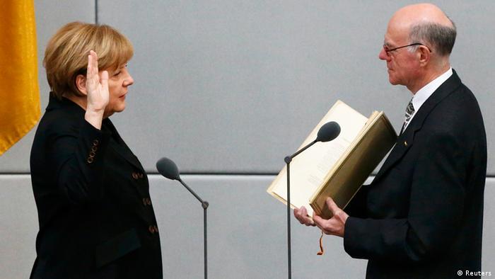 Merkel is sworn into office in 2013