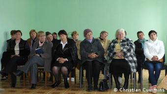A picture of villagers to discuss water supply in their village in Moldova.