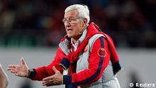 Marcello Lippi, coach of China's Guangzhou Evergrande, gestures to Guangzhou Evergrande's Zhang Linpeng during their FIFA Club World Cup soccer match against Bayern Munich at Agadir Stadium in Agadir December 17, 2013. REUTERS/Ahmed Jadallah (MOROCCO - Tags: SPORT SOCCER)