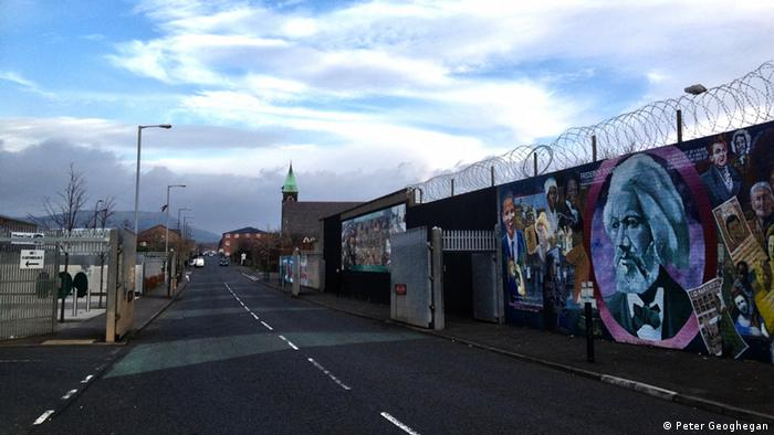 The peace wall separating Catholic and Protestant communities on Cupar Way in Belfast (Photo: Peter Geoghegan)
